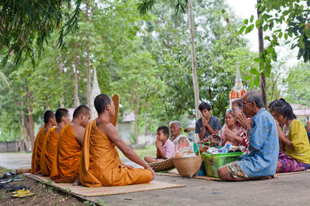 SURIN, THAILAND - September 18   Unidentified people will make merit, charity with monks for deceased on September 18, 2013 in Surin, Thailand