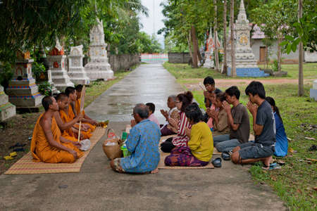 ism: SURIN, THAILAND - September 18   Unidentified people will make merit, charity with monks for deceased on September 18, 2013 in Surin, Thailand Editorial