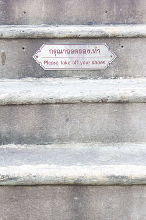 thai language:  take off your shoes  sign and Thai language before go to on temple