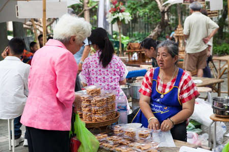Bangkok, Thailand - October 20, 2013 : Unidentified Thai people shopping at retro maket  with flower on October 20, 2013.