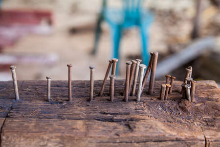 Tack in old wooden  for frizzle steel in construction site photo