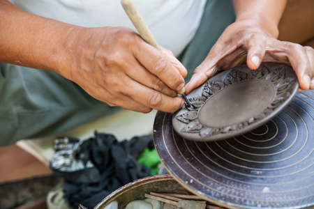 Hand carved pottery thai style at koh kret island Thailand photo