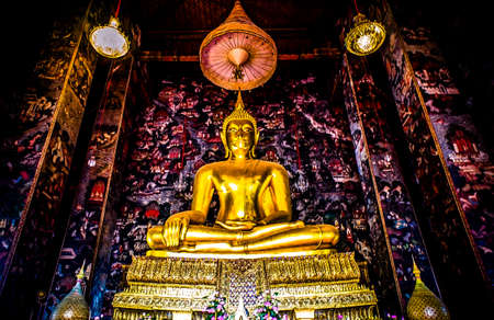 golden buddhas in wat sutat, bangkok photo