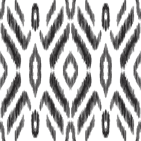 Abstract ethnic background. Black and white Ikat seamless pattern. A design may be used for fashion textile, fabric, wallpaper, card or wrapping paper. Stock Photo