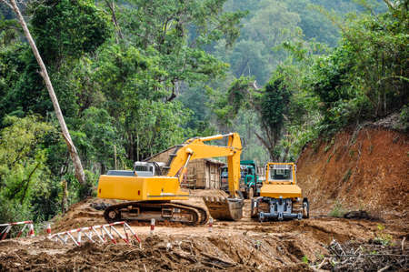 excavator and track in the road construction job, Myanmar Reklamní fotografie