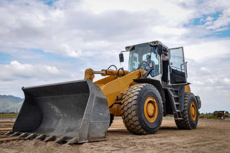 bulldozer performing job, in the construction site, Myanmar Stock Photo