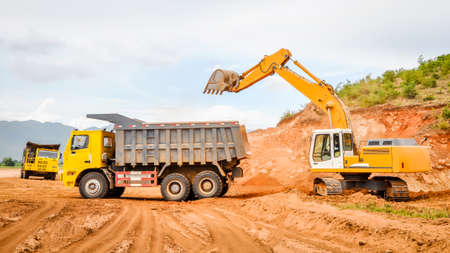 excavator and track in the road construction job, Myanmar Stock Photo