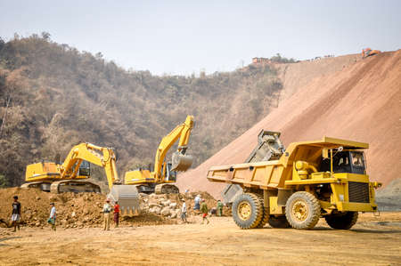photo of excavator and truck, in Hpa Kant jade mine, Myanmar