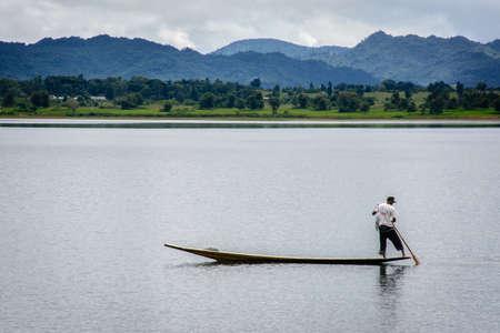 Fisherman in Ngwe Taung Dam, Kayah State, Myanmar, Oct-2017