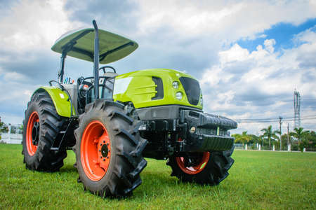 brand new tractor on the grass ready to perform jobs, Nov-2017 Stock Photo