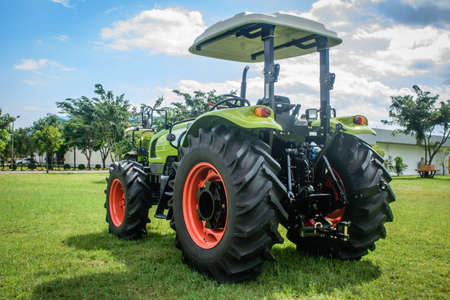 brand new tractor on the grass, ready to perform jobs, Nov-2017