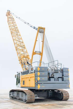 photo of huge crawler crane with isolated background