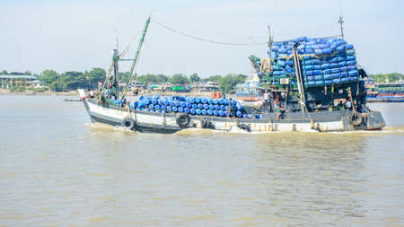 fishing boat in Hlaing river, Myanmar. They go to off-shore and fishing Editorial