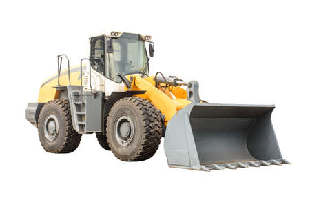 Closeup photo of big wheel loader, with isolated background