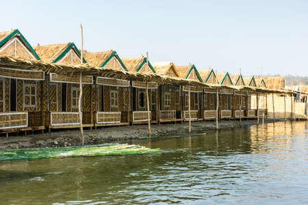 photo of bamboo lodgings beside the Man river, at Shwe Set Taw pagoda, Myanmar