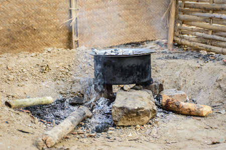 photo of rice pot, traditional cooking style, at countryside of Myanmar Imagens