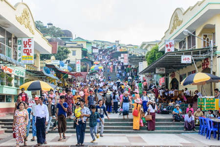 shops and houses on the Kyaik Htee Yoe mountain, Mon State, Myanmar. People are crowded. March-2018 Editorial