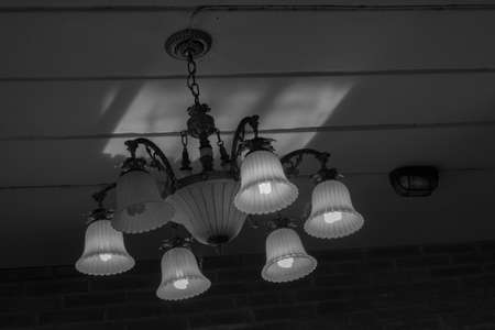 chandelier: Chandelier on the ceiling of the house in silhouette color. Stock Photo