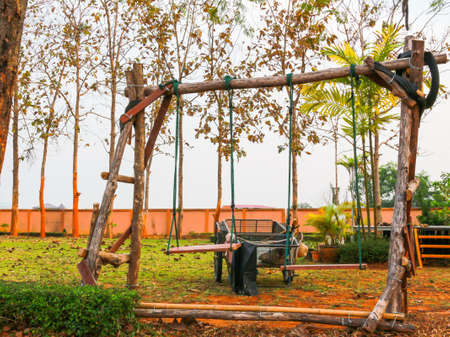 swing set: The wood swing set and vehicle in the yard for children to play. Stock Photo