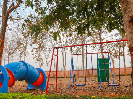 swing set: The colorful swing set and the big tube toy in the garden. Stock Photo