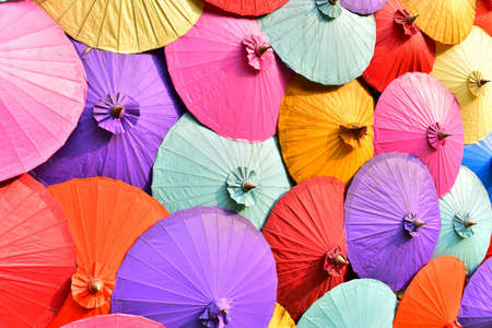Full frame umbrellas are vary colorful background.