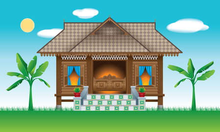 A beautiful traditional wooden Malay style village house.  With village day's scene.