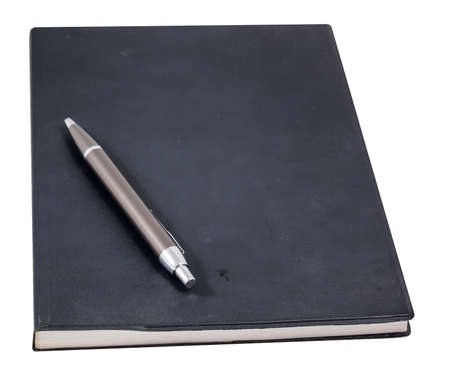a brown pen on black book photo
