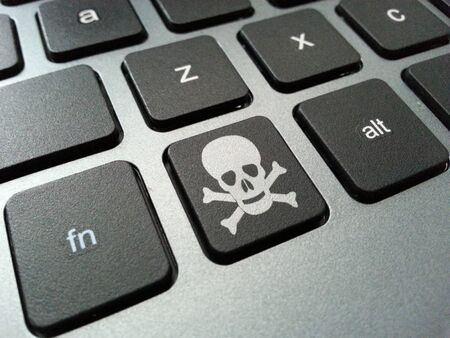 peripherals: An illustration of a computer keyboard button with the skull and crossbones symbol. The illustration can be related to health risks posed by prolonged use of computer peripherals such as carpal tunnel syndrome, obesity and eye strain.