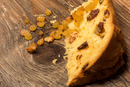 ambient: Panettone bread and ingredients on rustic wood ambient.