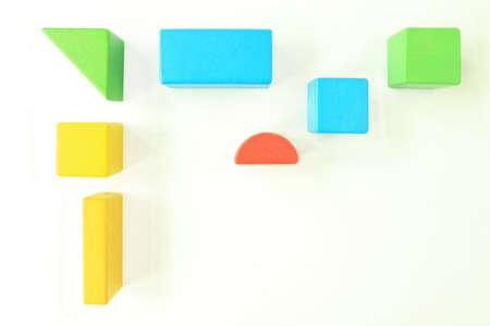 puerile: Toy Wooden Blocks on White
