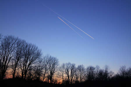 bluish: Jet Trails on Evening Sky