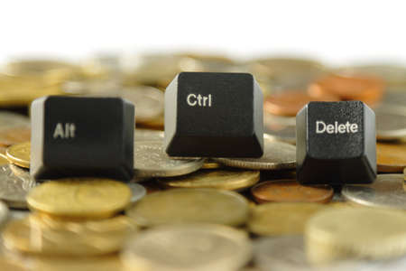 alt: Control Alt Delete Keys and Coins Stock Photo
