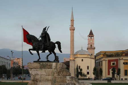Tirana, Albania, Skanderbeg  monument and Ethem Bey Mosque at Skanderbeg Square at dusk