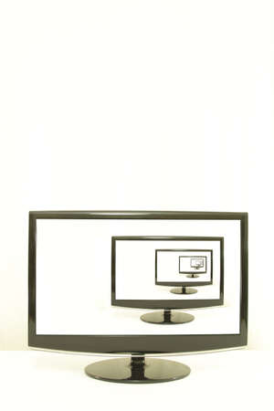 aligned: ComputerTV displays one on another, white screens, infinity, white background, right aligned Stock Photo