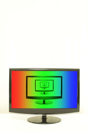 ComputerTV displays one on another, RGB colours on screen, infinity, white background, centered photo