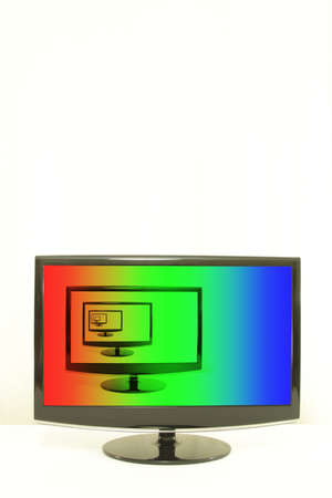aligned: ComputerTV displays one on another, RGB colours on screen, infinity, white background, left aligned Stock Photo
