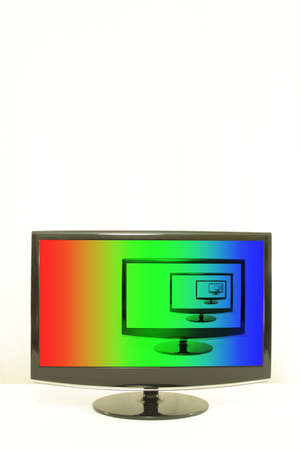 ComputerTV displays one on another, RGB colours on screen, infinity, white background, right aligned photo