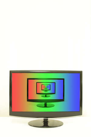 displays: ComputerTV displays one on another, RGB colours on screen, infinity, white background, centered Stock Photo