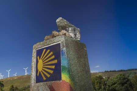Spain, Galicia, rainbow painted milestone at the Camino de Santiago Stock Photo - 23443322