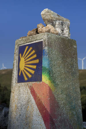 Spain, Galicia, rainbow painted milestone at the Camino de Santiago Stock Photo - 23443346