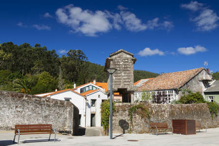 Spain, Galicia, Corcubion, horreo - traditional barn seen from the village square photo