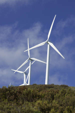 Spain, Asturias,  wind turbines on a hill, clouds photo