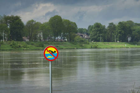 no swimming: Polnad, Kraków, flooded VistulaWisła river embankments, no swimming sign over the water