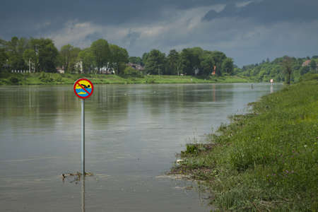 no swimming sign: Polnad, Kraków, flooded VistulaWisła river embankments, no swimming sign over the water