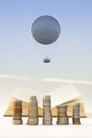 billions: Helium balloon seen against the sky at dusk, jest-trail visible in the background, book, and computer keys
