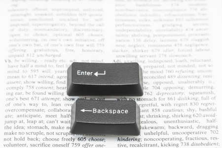 gutenberg: Enter and Backspace Computer Keys placed on a book page