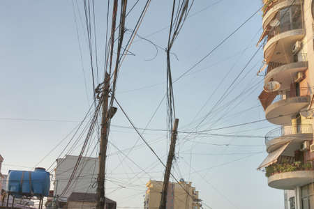 entangled: Entangled telecom and electric wires in the centre of Tirana, Albania Stock Photo