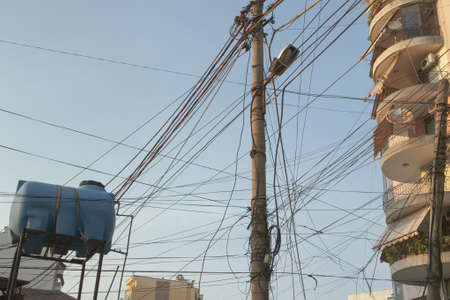 the local characteristics: Entangled telecom and electric wires in the centre of Tirana, Albania Stock Photo