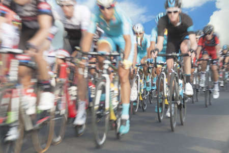 Cycling race participants, motion blur, zoom in, sky in the background Stock Photo - 44054016