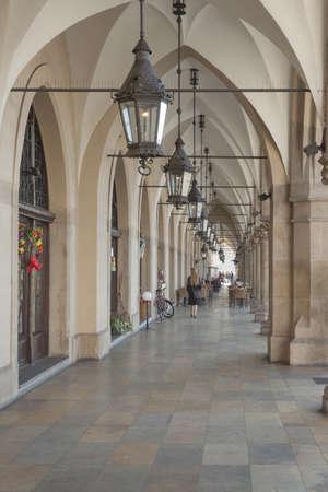 main market: Poland, Krakow, Main Market, Sukiennice Cloth Hall arcade, midday